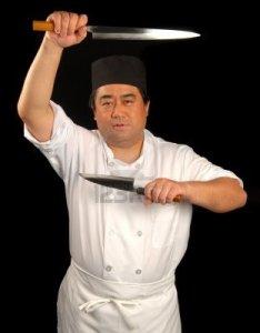 2701767-asiatiche-che-presentano-sushi-chef-con-i-suoi-coltelli